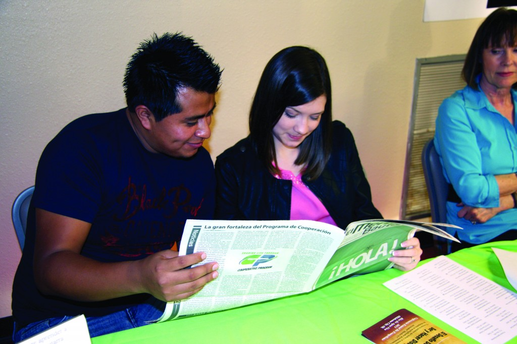 Joél and Rebekah Juárez read the first-ever issue of El Mensajero Bautista, a new quarterly Spanish version of the Baptist Messenger.