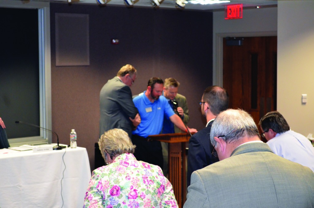 Oklahoma City, Southern Hills Pastor Doug Melton prays for Jeremy Freeman as BGCO Executive Director-Treasurer Anthony L. Jordan offers support. (Photo: Chris Doyle)
