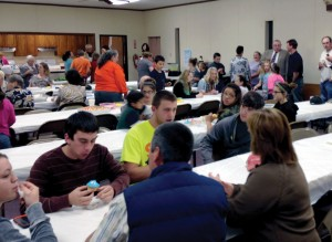 Attendees enjoy a cupcake fellowship.