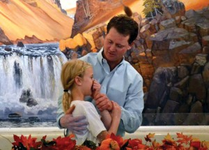 Shawn Nunley, member of Sterling, First, baptizes his daughter, Jadyn.