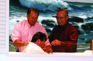 Gary Caldwell, pastor of Piedmont, First, left, joined Wendell Lang, pastor of Yukon, Surrey Hills, right, in baptizing Bill Turner, center.