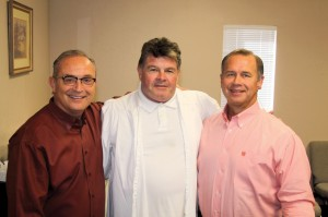 Turner, center, made a profession of faith after the prayer and influence of the two churches pastored by Lang, left, and Caldwell, right.