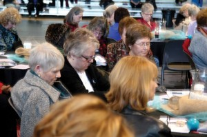 Women from around Oklahoma spend time in prayer during the Women's Session at the State Evangelism Conference.