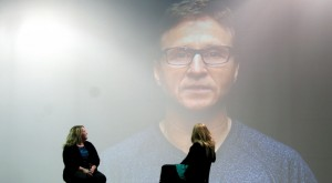 Oklahoma City Thunder head coach Scott Brooks surprises Lorelei Decker with encouraging words before she presents her story with her mom Andrea.