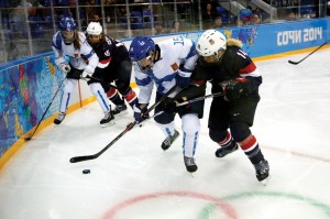 Schleper (15 in background) battles a Finland player. Schleper shares how her Christian faith impacts her game.
