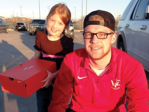 Hayden Blessing and a friend collect donated shoes for Witness Kicks.