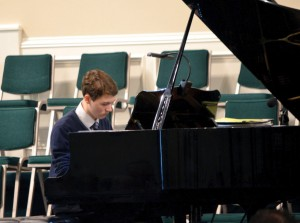 Griffin plays an arrangement of Holy, Holy, Holy during Night of Worship.