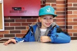 Bennett Morris sports one of the Witness Kicks hats that were given away at OBU's Witness Kicks Night. He helped collect 61 pairs of shoes from fans that evening.