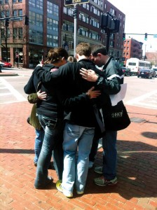 Members of the mission team prays with a Boston resident in the city. Prestonwood's Young Singles ministry had been sending teams to help Boston church planters for more than a decade.