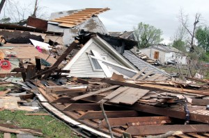 A house is left flattened by the tornado in Quapaw.