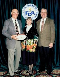 Lower poses with his wife Elaine and legendary Dallas Cowboys coach Tom Landry at an FCA event.