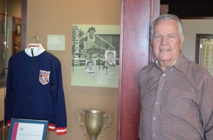 Gary Lower stands next to Jim Bolding's exhibit at the Oklahoma Sports Hall of Fame. Lower coached the world track record holder in high school.