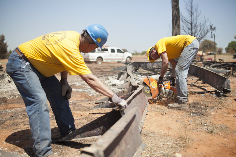 Oklahoma Baptist Disaster Relief teams clear debris at home sites in Guthrie on Wednesday. (Photo: Jonathan Burkhart)