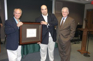 From left, Kevin Clarkson, pastor of Moore, First and Kyle Duncan, Business Administrator of Moore, First, receive a certificate of appreciation from BGCO Executive Director-Treasurer Anthony L. Jordan and the BGCO board for the church's donation of a 5-acre tract of land to be used as a storage/launch site for BGCO Disaster Relief.