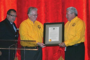 From left, Rep. Mark McBride, R-Moore, presents a citation from the Oklahoma State House of Representatives praising Oklahoma Baptist Disaster Relief for its role in the Moore tornado recovery.