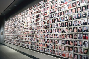 "A wall displays the photos of victims of the attacks, putting ""faces"" to the tragedy."