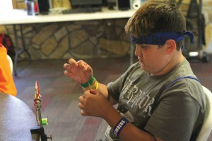 "At the Montana Missions Stop, campers learn how to make ""Wolly Worms,"" used for fly fishing."