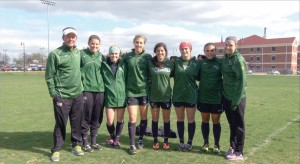 OBU Women's Soccer Coach Michael White, left, poses with his players who are participating in a pre-World Cup ministry trip in Brazil.