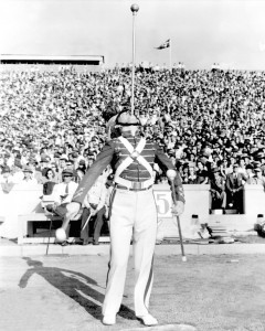While attending the University of Oklahoma in the 1940s, Ed Walker was a drum major who excelled in balancing a baton on his chin while twirling two others.