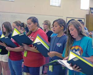 Resound choir, composed of junior high students, quickly learned their performance pieces with one full day of practice before their performance.