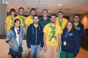 Michael Davis, center with green shirt, poses with the Falls Creek Audio-Video production crew.