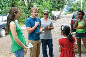 Dane Van Ryckeghem, center, and some teammates share the Gospel with Brazilians in a community on the outskirts of Rio de Janeiro.