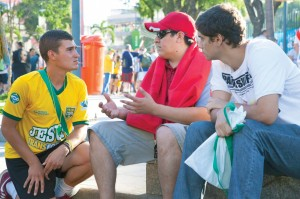 Nick Smirniotopoulos, a recent graduate of Virginia Tech, left, shares the Gospel with soccer fans outside Rio de Janeiro's Maracana stadium.