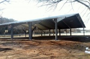 The sports pavilion at the recreation area down by the river now features covered basketball courts.