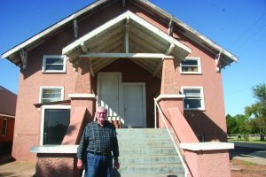 Carl Thionnet, director of missions for Concor-Kiowa Association, and interim pastor at Burns Flat, First, stands in front of the church building where he was baptized as an 8-year-old. The original structure was maintained as the church built on to it with a new worship center and educational space