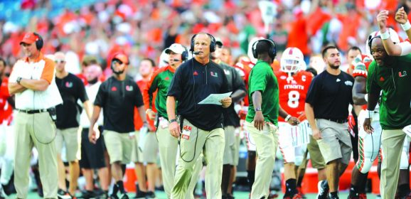 Coach Richt offers the Word of God to his team